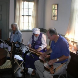 Interior photo, dulcimer players